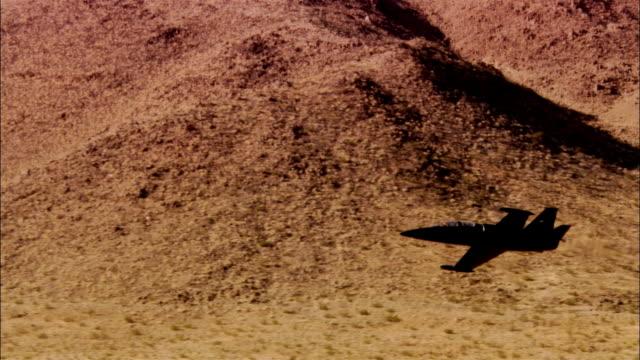 air to air, usa, california, mojave desert, aero l-39 albatross flying above desert - unknown gender stock videos & royalty-free footage
