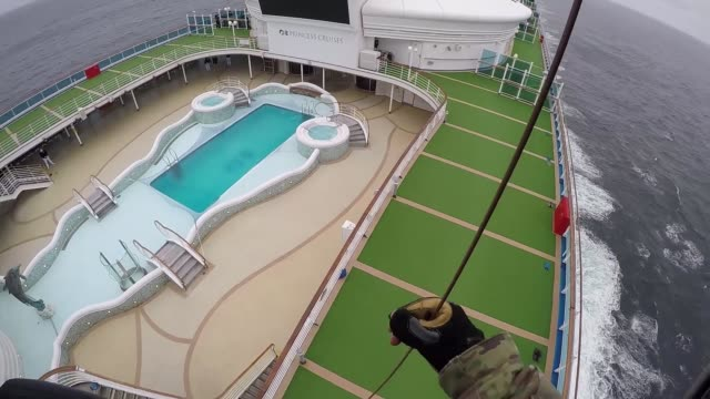 california national guard's 129th rescue wing delivering covid-19 test-kits to the grand princess cruise liner off the coast of california. - cruise collection stock videos & royalty-free footage