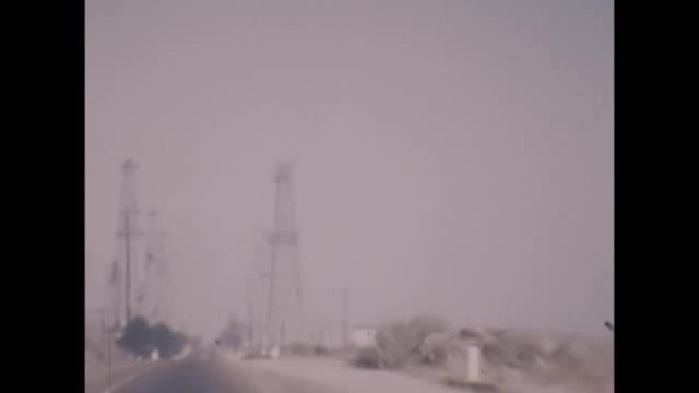 1957 california oil field derricks from car - 1957 stock videos & royalty-free footage