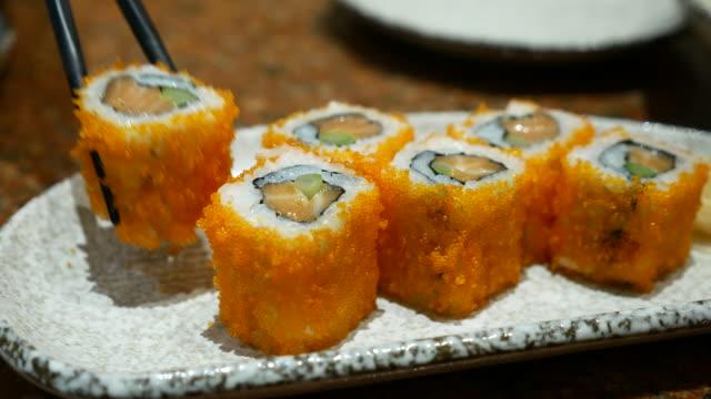 california roll sushi japanese food eating, 4k(uhd) - toro fish stock videos and b-roll footage