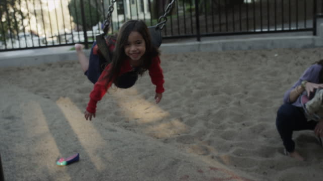 usa, california, san francisco, alamo square park, girl (4-5) swinging in playground - exhilaration stock videos and b-roll footage