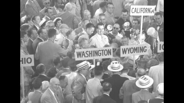 vídeos de stock, filmes e b-roll de california senator richard nixon on convention floor shaking hands and smiling while talking to delegates photographers in crowd can see state signs... - 1952