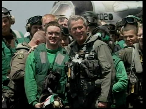 seq george w bush with troops aboard aircraft carrier with banner 'mission accomplished' george w bush speech sot major combat operations in iraq... - bush stock videos & royalty-free footage