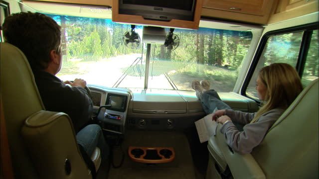 CU, USA, California, Shaver Lake, Couple giving high five in motor home