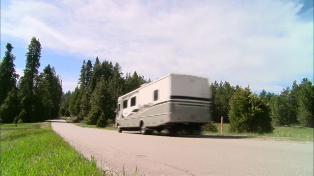 ms, usa, california, shaver lake, motor home driving on country road, rear view - camper van stock videos and b-roll footage