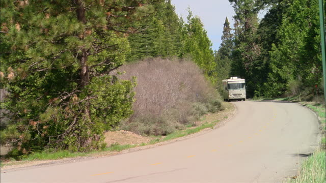 ms, usa, california, shaver lake, motor home driving on country road - camper van stock videos and b-roll footage
