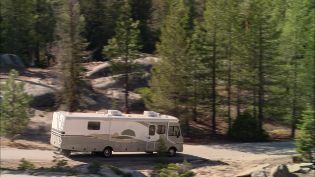 ha, ms, ts, usa, california, shaver lake, motor home traveling through forest - camper van stock videos and b-roll footage