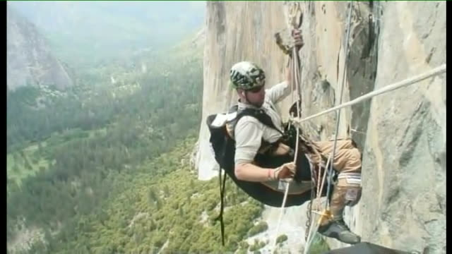 california yosemite national park reporter to camera various shots of major phil packer on 5th day of climb up el capitan mountain packer speaking to... - yosemite national park stock videos & royalty-free footage