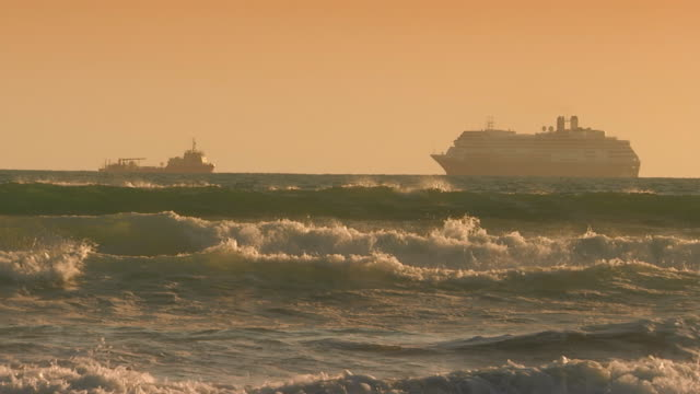 CaliforniaCruise ship passing a freighter on the ocean