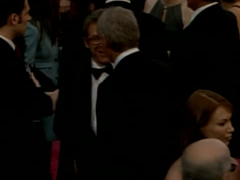 calista flockhart and harrison ford on red carpet at oscars los angeles 24 february 2008 - handsome people stock videos & royalty-free footage