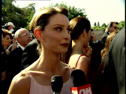 calista flockhart talks to reporters on the red carpet at the 50th annual emmy awards. - calista flockhart stock-videos und b-roll-filmmaterial