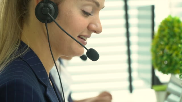 call center business woman talking on headset - cross section stock videos & royalty-free footage