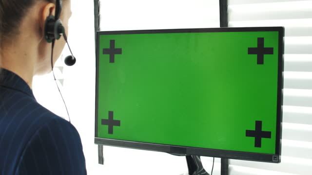 call center support customer on her computer in office - headset stock videos & royalty-free footage
