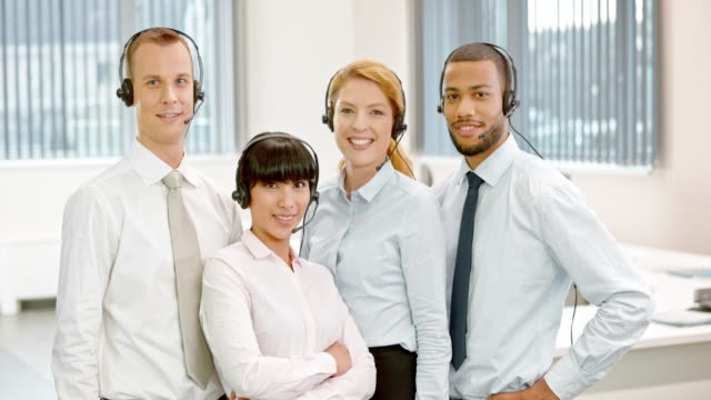 ds call center team portrait - four people stock videos & royalty-free footage