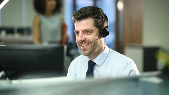 call centre operator - headset stock videos & royalty-free footage