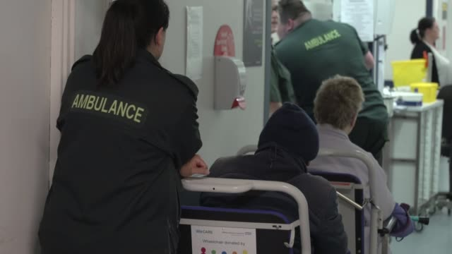 call for 250 million pound boost for hospitals to avoid 'winter crisis' milton keynes university hospital int ambulance worker stands at reception... - 国民保険サービス点の映像素材/bロール