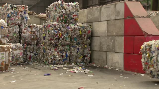 call for end to plastic waste exports uk various shots of plastic waste being sorted and moved at recycling plants in avonmouth and dagenham shredded... - recycling stock videos & royalty-free footage