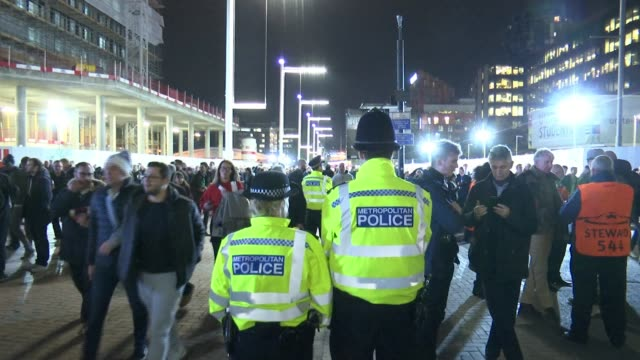 Call for football clubs to pay more of the cost of policing their grounds Wembley Wembley Stadium Police offciers watching fans along outside ground...