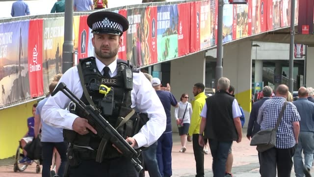call for football clubs to pay more of the cost of policing their grounds r270517013 / 2752017 wembley stadium armed police officer on duty at the fa... - 武器点の映像素材/bロール