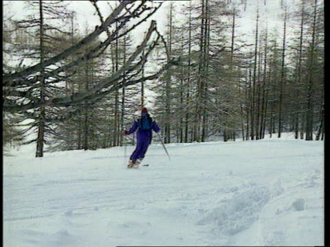 call for stronger experience restrictions on ski slopes; france: the alps: val d'isere: ext / snow on ground wide shot skiers to and fro in valley... - ski lift point of view stock videos & royalty-free footage
