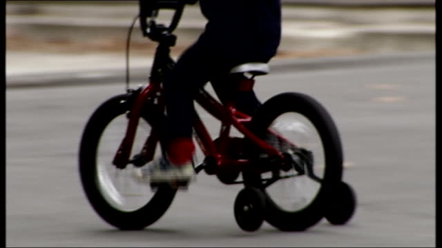 call for total ban on smacking children anonymous shot child riding bike with stabilizers - stabilisers stock videos & royalty-free footage
