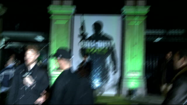 'call of duty modern warfare 3' launch in london celebrity arrivals england london photography** men dressed as soldiers / flashing lights projected... - i'm a celebrity... get me out of here stock videos & royalty-free footage