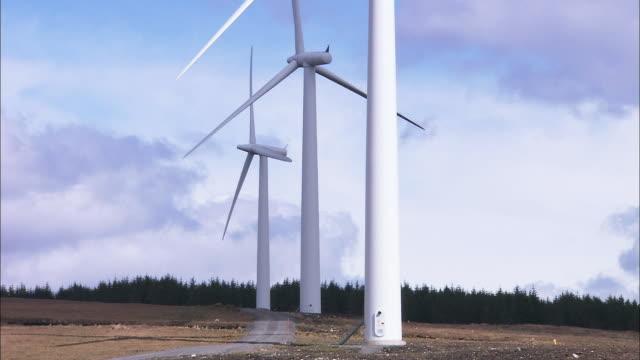 callagheen wind farm, three turbines close up, northern ireland - northern ireland stock videos & royalty-free footage