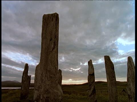 Callanish standing stones under vast grey clouds in sky, Outer Hebrides