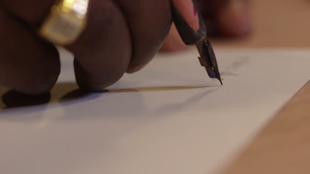 a calligrapher writes the letters a to h and 'western australian', uk. - pen stock videos & royalty-free footage