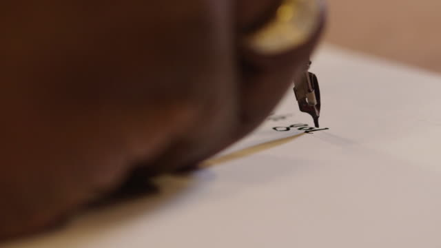 a calligrapher writes the words 'gothic textura', uk. - pen stock videos & royalty-free footage