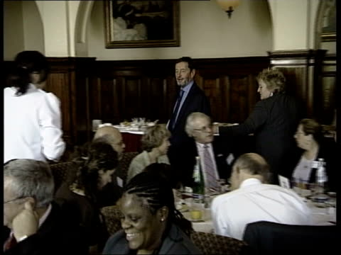 calls for david blunkett to resign; tx blunkett along through room to sit at table - david blunkett stock videos & royalty-free footage
