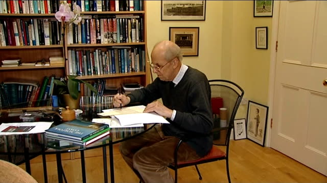 calls for maria miller to quit over expenses row t11031419 / lord tebbit sitting at table and looking through manuscript side view tebbit - manuscript stock videos and b-roll footage