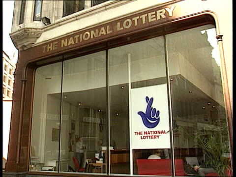 calls for more regulatory powers; business unit clipreel england: london: national lottery hq pull out scratchcard taken from strip and scratched... - scratch card stock videos & royalty-free footage