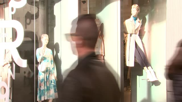calls for tax on new clothing items to reduce environmental cost england london ext various shots clothes in shop windows seda pir along with reporter - seda stock videos & royalty-free footage