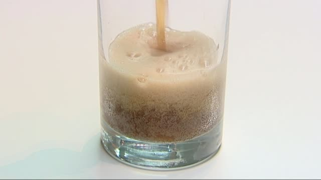 calls for tax on sugary drinks; date unknown coke poured into glass - sugar stock videos & royalty-free footage