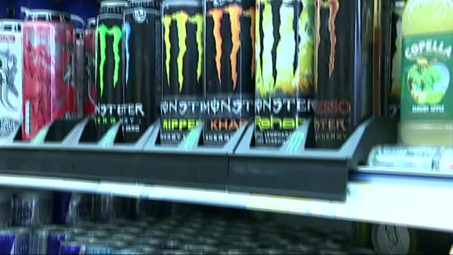 calls for tax on sugary drinks; lib england: london: int gv bottles and cans of sugary drinks on supermarket shelves close shots of cans of drink... - sugar stock videos & royalty-free footage