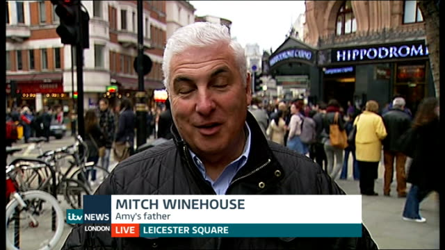 calls to name street in king's cross after amy winehouse; england: london: leicester square: ext mitch winehouse interview sot - talks of reaction to... - amy winehouse stock-videos und b-roll-filmmaterial