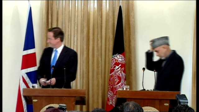 calls to review security of prime minister after afghan scare r10061006 int cameron and president hamid karzai at press conference - minister president stock videos and b-roll footage