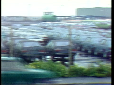 stockvideo's en b-roll-footage met calls to stop imports of japanese goods england kent sheerness ext pan parked imported toyota cars lr seen in compound pan ditto parked imported... - toyota motor