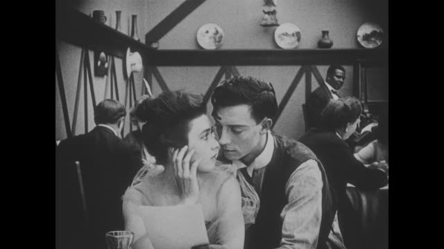 1918 calm chef (fatty arbuckle) throws hot coffee deftly to waiter (buster keaton), who hovers and sighs over female patron - buster keaton stock videos and b-roll footage