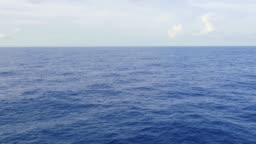 calm sea, endless deep blue ocean and the horizon