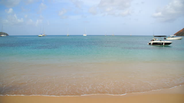 calm sea washing onto shore / st lucia, caribbean - st lucia stock videos & royalty-free footage