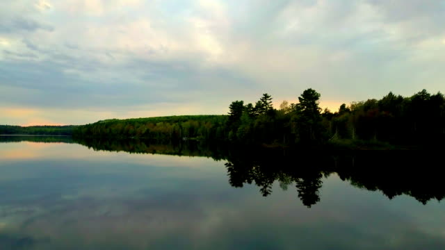 calm wilderness lake at dusk - upper peninsula stock videos & royalty-free footage