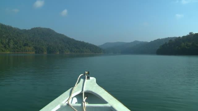 calming boat cruise along temenggor lake, kl - push in stock videos & royalty-free footage