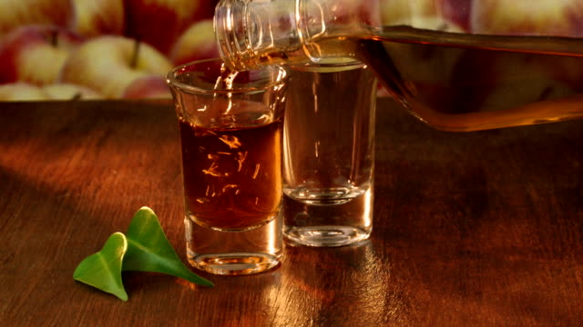 calvados-apple brandy in two shot glasses - calvados stock videos and b-roll footage