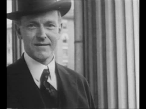 calvin coolidge in office with large bouquet of flowers in vase on desk / cu coolidge wearing a hat / boston police officers leave police... - coolidge calvin stock videos & royalty-free footage