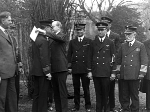 calvin coolidge pinning medal on admiral byrd as other officers look on / documentary - 1926 stock videos & royalty-free footage