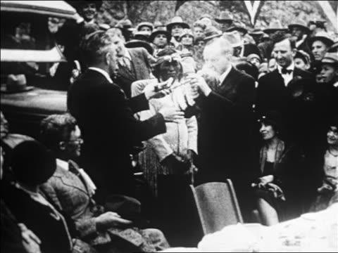 calvin coolidge smoking peace pipe with pima + apache indians / san carlos, az / newsreel - 1926 stock-videos und b-roll-filmmaterial