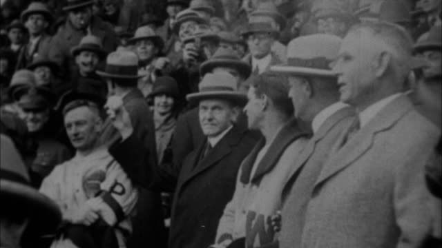 vídeos de stock, filmes e b-roll de calvin coolidge throwing at first pitch at world series / new york city new york usa - 1923