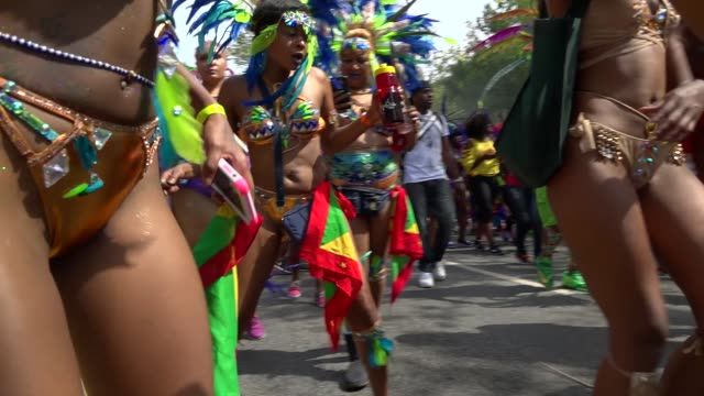 calypso soca music dancers during the annual labor day parade / eastern parkway crown heights brooklyn new york city usa also known as the west... - calypso stock videos and b-roll footage